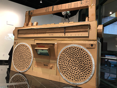 One exhibit item: a large replica boombox made of wood, cardboard, and other mixed materials