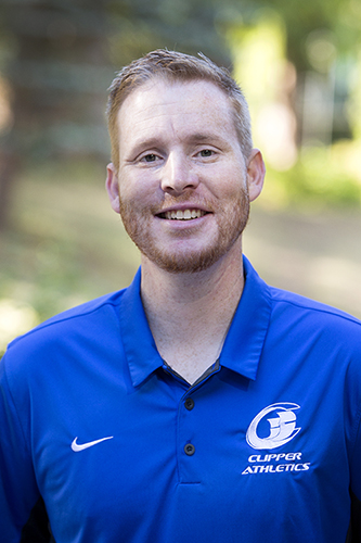 Coach Green in a blue Clippers athletics shirt