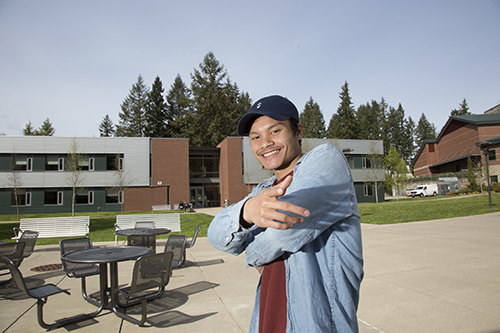 Chivan Smiling on a sunny spring day outside the Center for Student Success