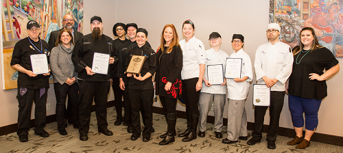 Group photo of SPSCC culinary and catering teams, Secretary Wyman, and SPSCC staff.