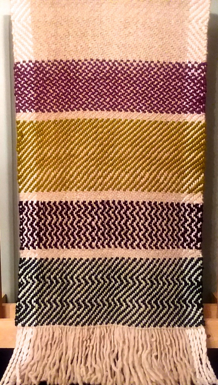 Woven multi-colored wall hanging
