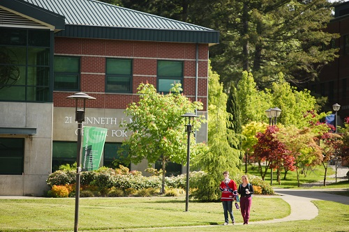 Two students walking on a path on SPSCC's Olympia campus