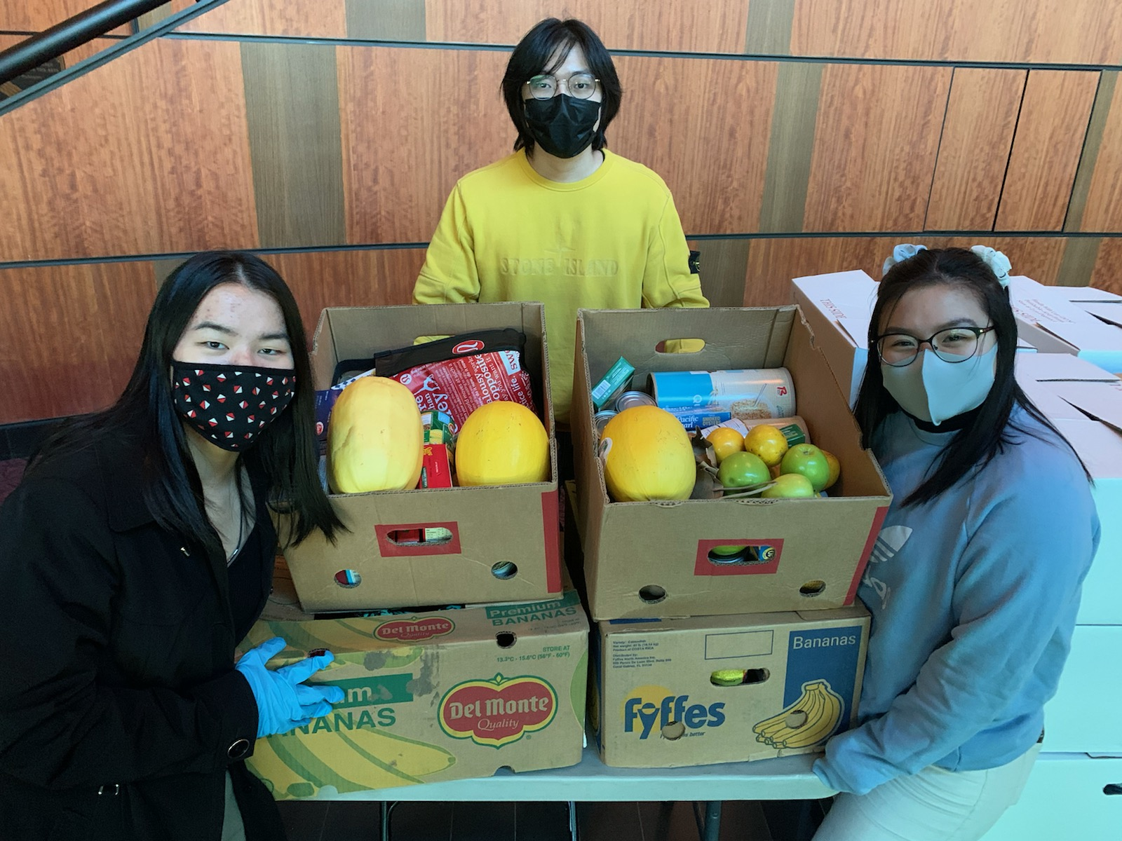 SPSCC students in masks with food pantry box of food