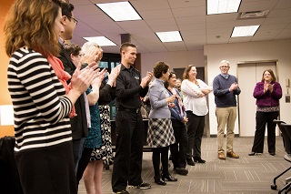 Faculty members who were awarded tenure stand to be recognized during at reception