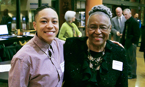 A smiling SPSCC student stands with Barbara Clarkson at the 2018 MLK Banquet