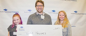 Student receives giant check at scholarship reception