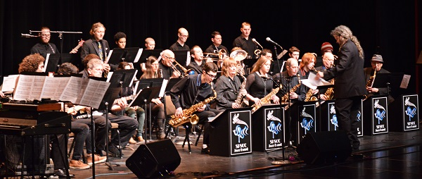James Schneider leading the jazz band on stage