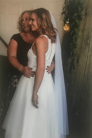 Doty poses with her daughter at her wedding