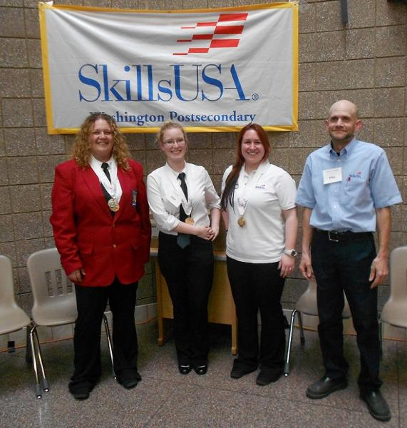Lyon, Mauerman, Young, and Masteller at the competition in front of SkillsUSA Banner