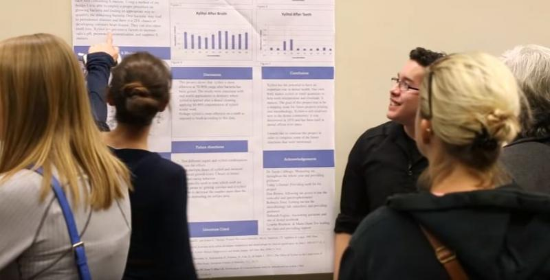 Photo of student presenting at 2016 poster presentation.