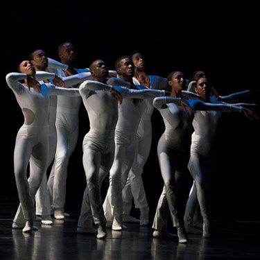 Eight PHILADANCO performers wearing white and blue