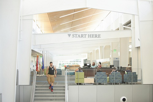 Start here desk in bldg. 22 and student on stairs.