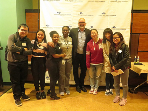 Scholarship recipients pose for a photo with SPSCC President Dr. Tim Stokes